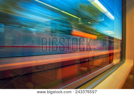 Abstract Motion-blurred View From A Moving Train. Motion Blur View From The Window Of A Fast Moving