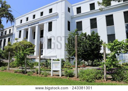 Tallahassee, Fl, Usa - May 13, 2018: Holland Building With Teaching Garden Signs. Teaching Gardens I