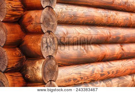 Background. Corner Of Blockhouse Closeup. Mahogany. A Log Wall Of Wooden House