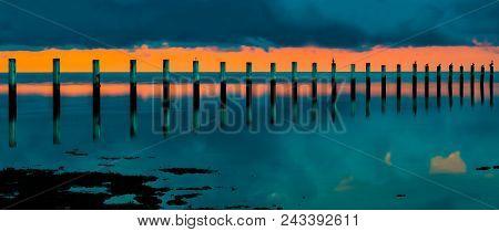 Ocean Palette: Sunrise Over Wooden Fishing Pillars In The Atlantic Ocean, Islamorada, Florida