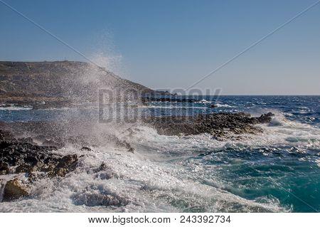 Photo Of Sea Water Beating Against Rock, Cirkewwa, Malta