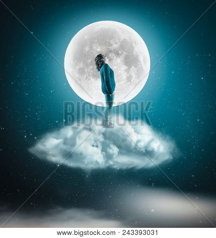 Woman Stand On A Cloud And Admires The Moon In The Night.