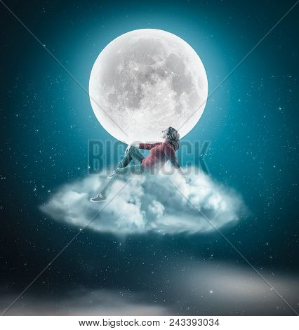 Woman Sits On A Cloud And Admires The Moon In The Night.