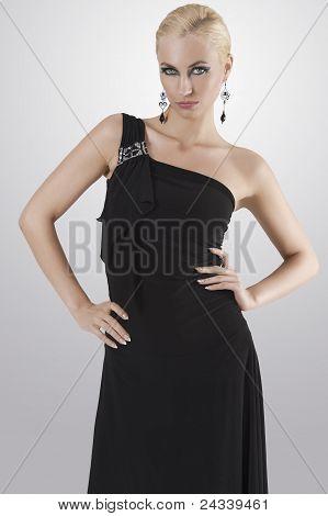 Blond Girl In Black Dress Posing Towards The Camera