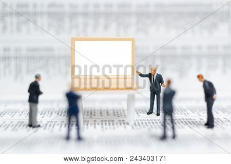 Miniature People: Businessman Presenting On White Screen Computer Laptop