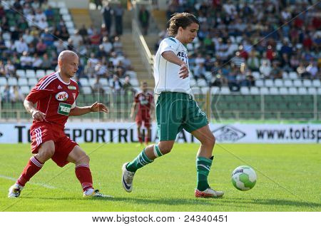 KAPOSVAR, HUNGARY - SEPTEMBER 24: Kornel Kulcsar (in white) in action at a Hungarian National Championship soccer game - Kaposvar (white) vs Debrecen (red) on September 24, 2011 in Kaposvar, Hungary.