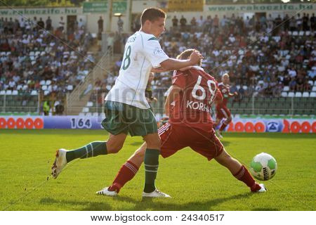 KAPOSVAR, HUNGARY - SEPTEMBER 24: Benjamin Balazs (in white) in action at a Hungarian National Championship soccer game - Kaposvar (white) vs Debrecen (red) on September 24, 2011 in Kaposvar, Hungary.