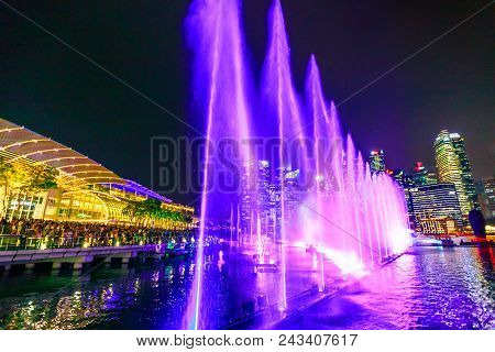 Singapore - April 26, 2018: People Watch From Event Plaza The Spectra: Light And Water Show, A Free
