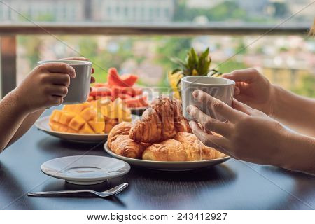Happy Family Having Breakfast On The Balcony. Breakfast Table With Coffee Fruit And Bread Croisant O