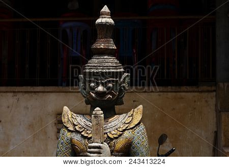 Spiritual Protector Statue From Wood In Buddhist Pagoda. Wooden Statue Of Warrior. Khmer Arts And Cr