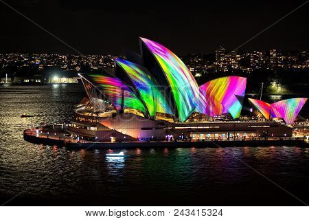 Sydney Opera House Illuminated With Beautiful Vibrant Multi Colour Imagery At Night