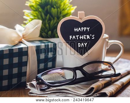 Happy Fathers Day Concept. Coffee Cup With Gift Box, Heart Tag With Happy Father's Day Text And News