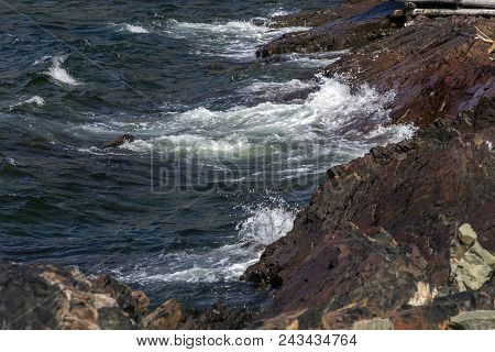 Rocky Fogo Island Coastline With Crashing Waves; Newfoundland