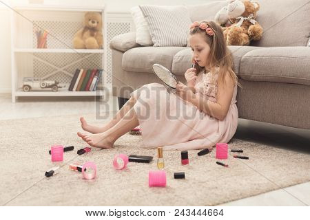 Little Girl Doing Make Up With Mom's Cosmetics