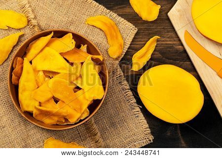 Dried Mango Fruit On Wooden Background. Selective Focus.