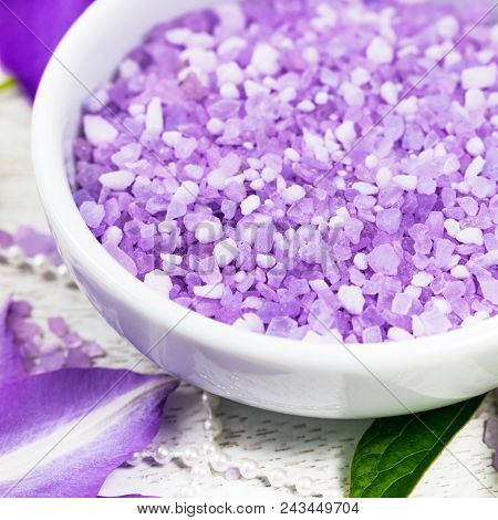 Purple Lilac And Clematis Salt For Spa And Aromatherapy. Selective Focus.