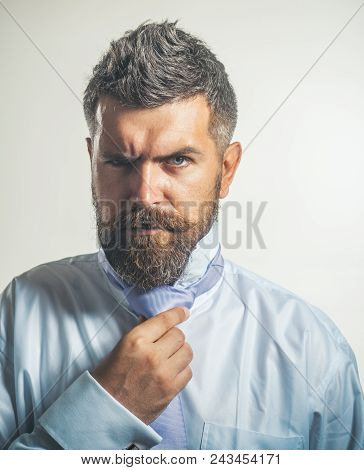 Bearded Man In White Shirt Adjusting His Necktie. Handsome Successful Trendy Businessman Executive W