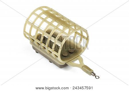 Brown Feeder Fishing Flat On An Isolated Background. Fishing Tackle Made With Plastic