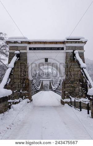 Old Stone Suspension Bridge In Norway Winter