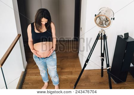 Pregnancy Details - Portrait Of Healthy Pregnant Woman Touching Belly And Looking At Belly