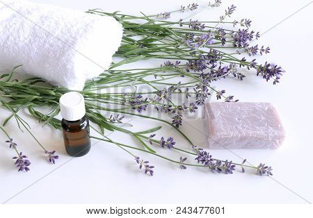 Spa Treatment And Massage Products With Towel, Aromatic Oil , Natural Soap And Lavender Flowers On A