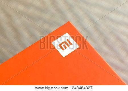 Kiev, Ukraine - May 28, 2018: Xiaomi Redmi 5 Plus Black New Smartphone With Orange Box Close Up Deve