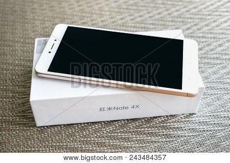 Kiev, Ukraine - May 28, 2018: Xiaomi Redmi Note 4x Gold White Smartphone With Box Developed By Xiaom