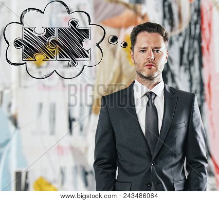 Handsome European Businessman Thinking About Puzzle Pieces On Blurry Background. Think And Teamwork