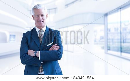 Portrait of senior businessman in front of his modern office