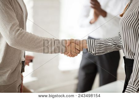 Close Up Of Company Ceo Leader Shaking Hand Of Female Employee, Congratulating With Work Achievement