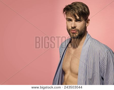 Serious Man. Bachelor In Blue Dressing Gown On Pink Background. Man With Sexy Torso In Bathrobe. Hom