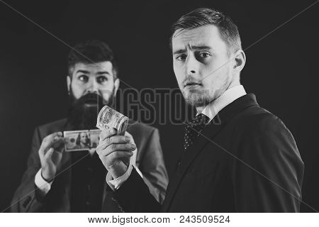 Sharing Of Profits Concept. Meeting Of Reputable Businessmen, Black Background. Man On Serious Face