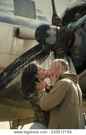 Passionate Couple Kissing, Boy And Girl. Couple Kissing In Front Of Propeller Of Old Plane On Sunny