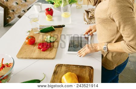 Healthy Food Concept. Woman Looking For Recipe Vegetarian Food On The Internet. Woman Cooking Health