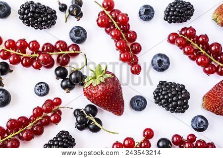 Mix Berries And Fruits On White Background. Ripe Blueberries, Blackberries, Strawberries And Red Cur