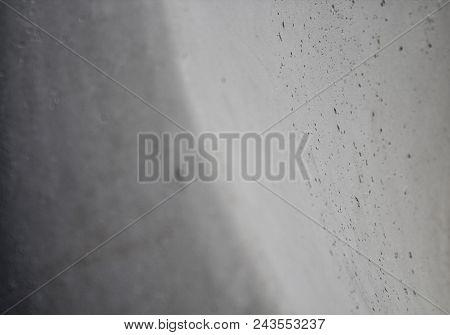 Abstract gray background. Gray background. Gray surface. Off-white. Grunge style. Gray grunge.