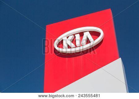 Moscow, Russia - May, 2018: Kia Automobile Dealership Sign Against Blue Sky. Kia Is A South Korean M