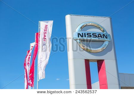 Moscow, Russia - May, 2018: Nissan Automobile Dealership Sign With Flags Against Blue Sky. Subaru Is
