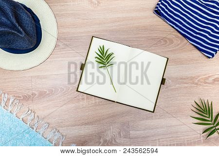 Top View Of Vacation Accessories With Blank Notebook And Summer Beach Items. Lay Flat Fashion Backgr