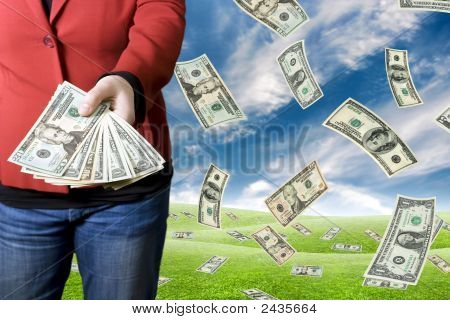 Girl Picking Up Money Falling From The Sky