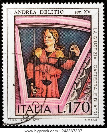 Luga, Russia - January 23, 2018: A Stamp Printed By Iceland Shows Lady Justice Holding Balance Scale