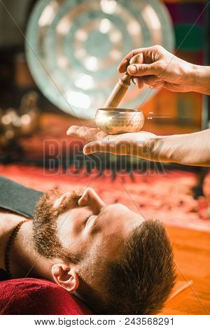 Tibetan singing bowl in sound therapy, vertical image poster