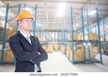 Male Architect Standing With Smiling At Warehouse. People Working Concept.