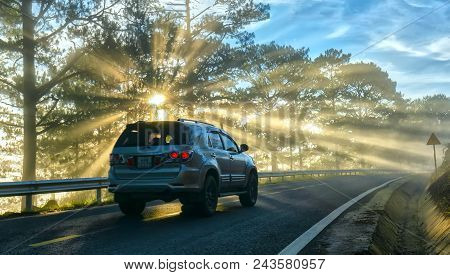 Da Lat, Vietnam - May 13, 2018: Cars Driving On The Country Asphalt Road Through Pine Forests With R