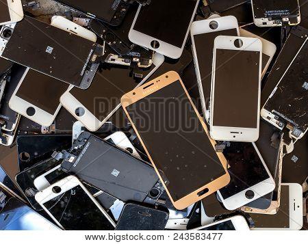 Chiang Rai, Thailand: August 23, 2017 - Heap Of Broken Smartphone Screen (e-waste, Electronic-waste)