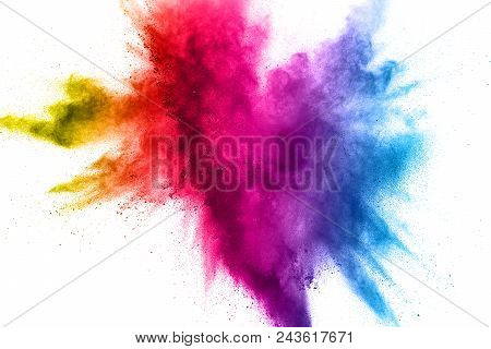 Multi Color Powder Explosion On White Background. Bizarre Forms Of  Colorful Dust Particles Splash O