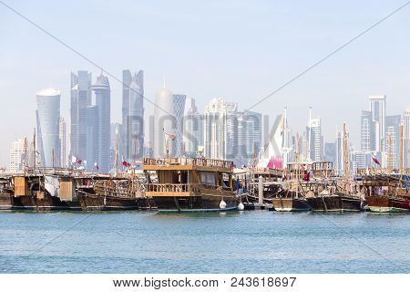 Doha, Qatar - December 25, 2017 : Traditional Boats Called Dhows Are Anchored In The Port Near Museu