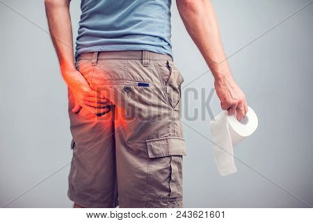 Man Suffers From Diarrhea Holds Toilet Paper Roll. The Guy Is Holding The Ass Of Himself Trying To H