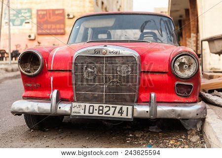 Aqaba, Jordan - May 18, 2018: Red Abandoned Mercedes-benz W110 190, Midsize Automobile Stands On A R