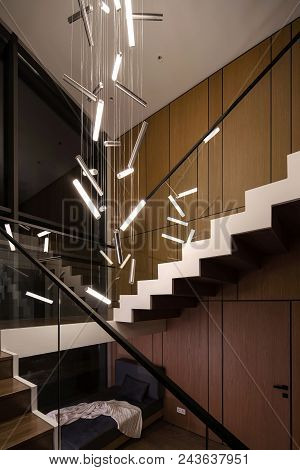 Stylish Modern Interior With Wooden Walls And A Stair With Wooden Rungs And A Glass Railing. There A